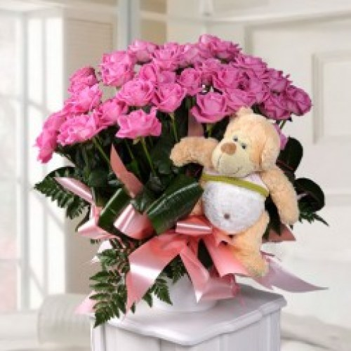 arrangement-of-roses-and-teddy-bear